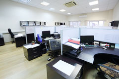 Empty places of work with desktops separated by partitions. Stock Image
