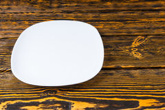 Empty plain white plate on a wood background Stock Photo