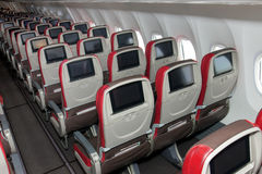 Empty planes. Aisle seats on empty planes royalty free stock photography