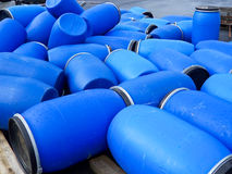 Empty plastic barrels with lids. Royalty Free Stock Images