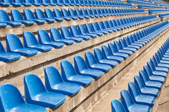 Empty plastic blue seats Stock Photos