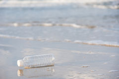 Empty plastic bottle on the beach in the morning. Empty plastic bottle on the beach in the morning Royalty Free Stock Photo