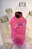 Empty plastic bottles. Several kind of transparent empty bottles and one in pink color Stock Photos