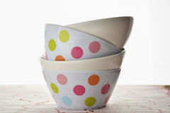 Empty plastic bowls with colored spots Royalty Free Stock Photos