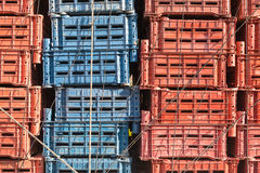 Empty plastic cargo boxes are stacked Stock Images