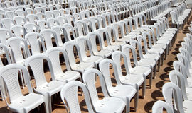 Empty plastic chairs in row Royalty Free Stock Photography