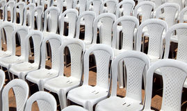 Empty plastic chairs in row Royalty Free Stock Photos