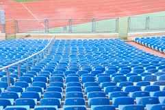 Empty Plastic Chairs at the Stadium Stock Images