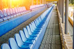 Empty plastic chairs in the stands of the stadium Royalty Free Stock Image