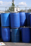 Empty plastic drums for chemicals at a recycling location. Empty plastic drums for chemicals stock photo