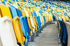 Empty plastic seats in a footbal or soccer stadium. 2016 sport background Stock Image