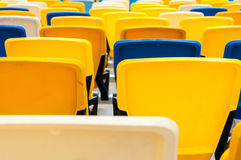 Empty plastic seats in a footbal or soccer stadium. 2016 sport background Royalty Free Stock Images