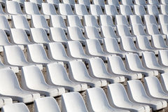 Empty plastic seats on football stadium Stock Photography