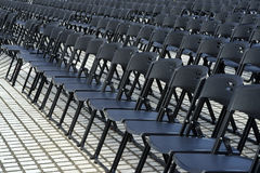 Empty plastic seats in public square Royalty Free Stock Photo