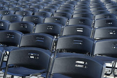 Empty plastic seats in public square Royalty Free Stock Image