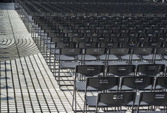 Empty plastic seats in public square Stock Photography