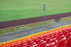 Empty plastic seats in a stadium Stock Images