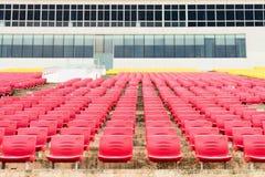 Empty plastic seats at stadium Royalty Free Stock Photo