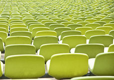 Empty plastic seats at stadium Stock Photo