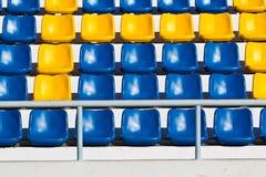 Empty plastic seats at stadium, Stock Photo