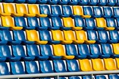 Empty plastic seats at stadium, Royalty Free Stock Images
