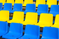 Empty plastic seats in a stadium Royalty Free Stock Photography