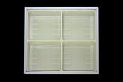 Empty plastic tray inside paper box Royalty Free Stock Photo