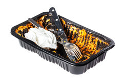 Empty plastic tray with remains of a premade lasagna Stock Image