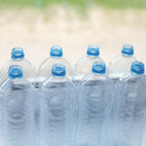 Empty plastic water bottles on table - recycling and food storage Stock Images