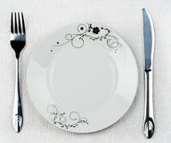 Empty plate. Table with empty white plate, fork and knife Royalty Free Stock Photography