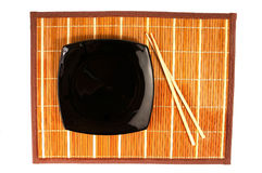 Empty plate. Japananese style plate on bamboo rug Royalty Free Stock Image