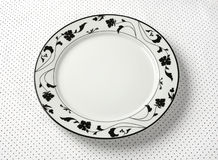 Empty plate. On dots tablecloth Royalty Free Stock Photography