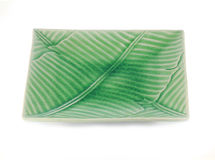 Empty plate with banana leaf texture Royalty Free Stock Images
