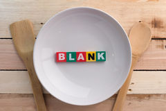 Empty plate with blank word. Concept  of Diet food on wooden table Stock Image