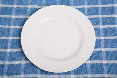 Empty Plate on Blue Towel Royalty Free Stock Photos