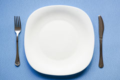 Empty plate on blue Stock Photos