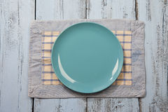 Empty plate on blue wooden background Stock Photo