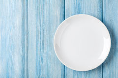 Empty plate on blue wooden background Stock Photos
