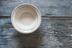 Top view empty dish on wooden background. Empty plate on blue wooden background. Top view with copy space royalty free stock photos