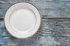 Top view empty dish on wooden background. Empty plate on blue wooden background. Top view with copy space stock image