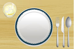 Empty plate and a bowl of lemonade Stock Photo