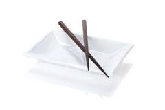 Empty plate and chopsticks Stock Photo