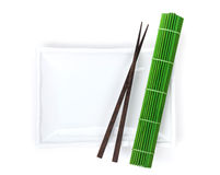 Empty plate, chopsticks and mat Stock Images
