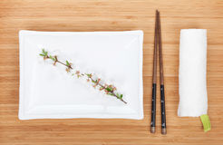 Empty plate, chopsticks and sakura branch Royalty Free Stock Image