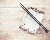 Empty plate and chopsticks on wooden table Royalty Free Stock Photos
