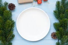 Empty plate with Christmas decoration, preparation for Happy New Year and Xmas royalty free stock photography