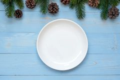 Empty plate with Christmas decoration, preparation for Happy New Year and Xmas royalty free stock images
