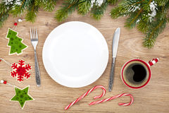 Empty plate, coffee cup and christmas decor Royalty Free Stock Photography