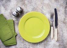 Empty plate on concrete table. Empty green plate on concrete table royalty free stock image