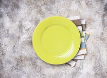 Empty plate on concrete table. Empty green plate on concrete table stock photo